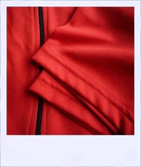 Banksia recumbent cycle jersey - Red - close-up sleeves